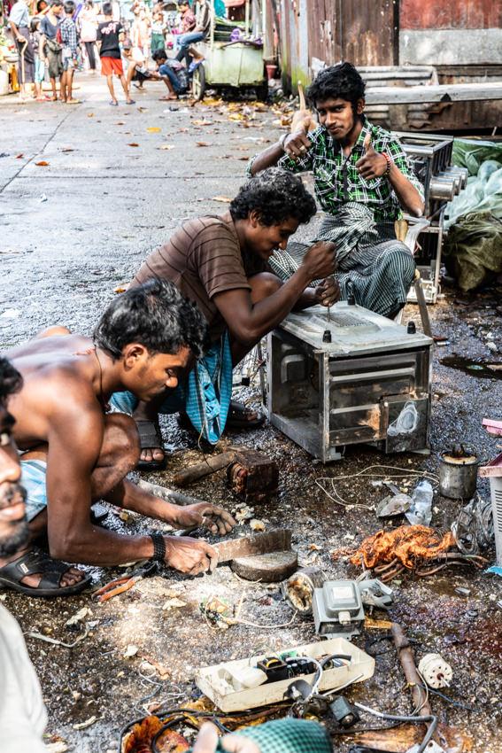 Men repairing electronic goods