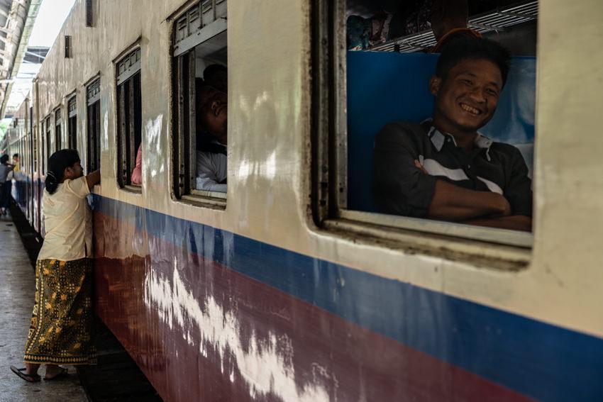 Smiling passenger and leave-taker on platform