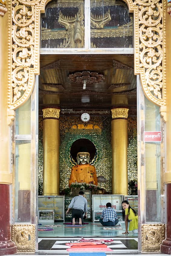 Buddha statue under clock
