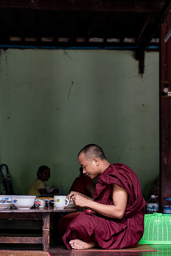 Buddhist monk having breakfast