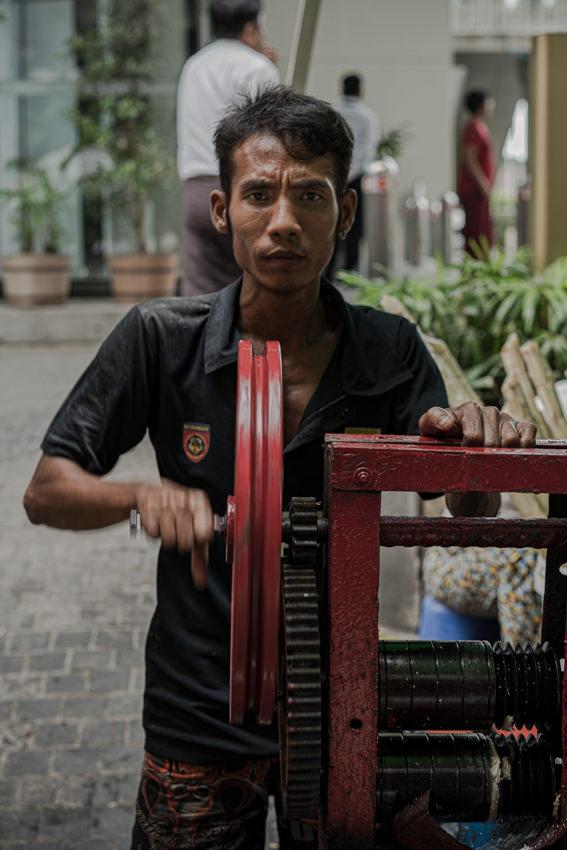 Man turning red handle