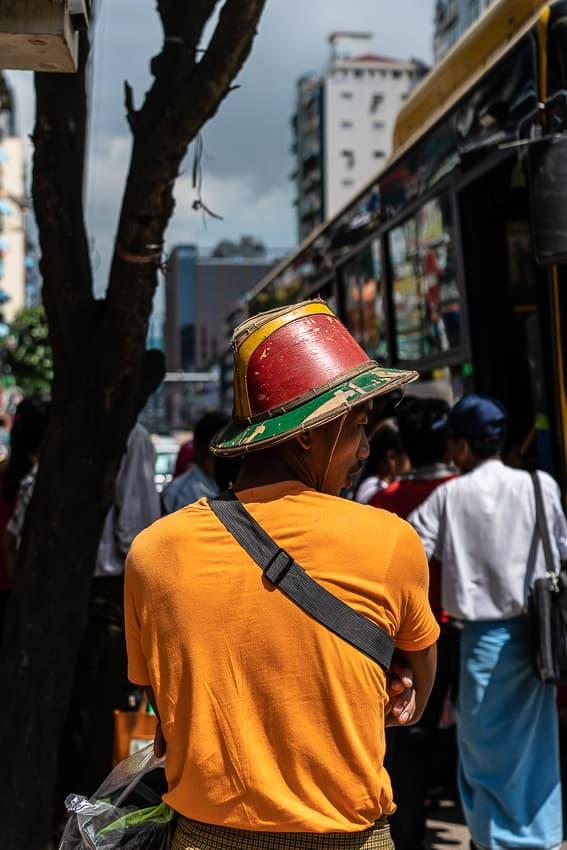 Man wearing vivid hat
