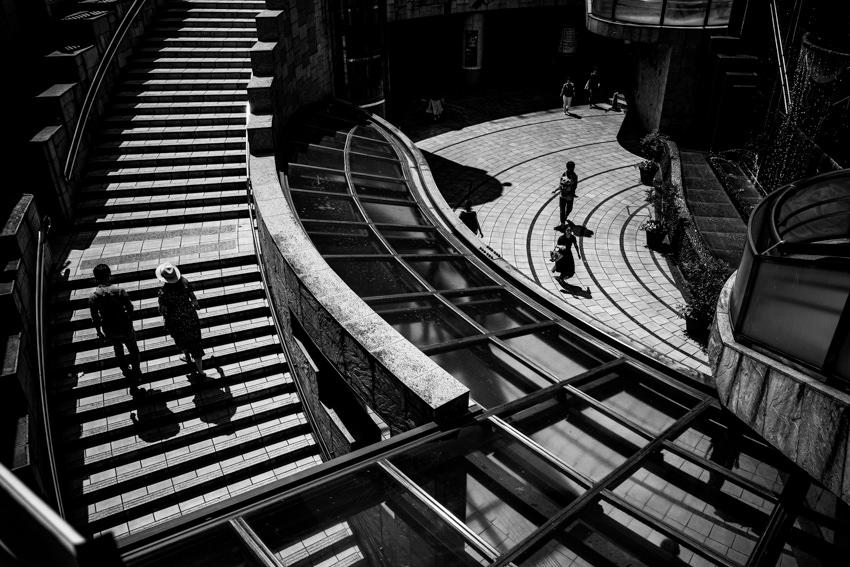 Couple climbing staircase