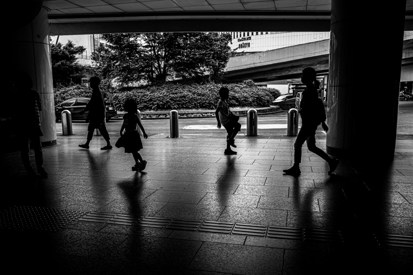 Silhouettes walking passage