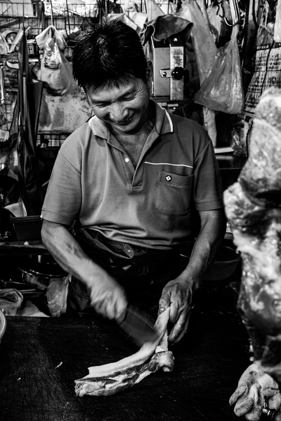 Butcher cutting happily