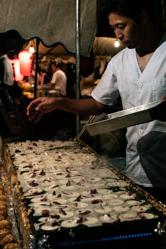 Man cooking Takoyaki