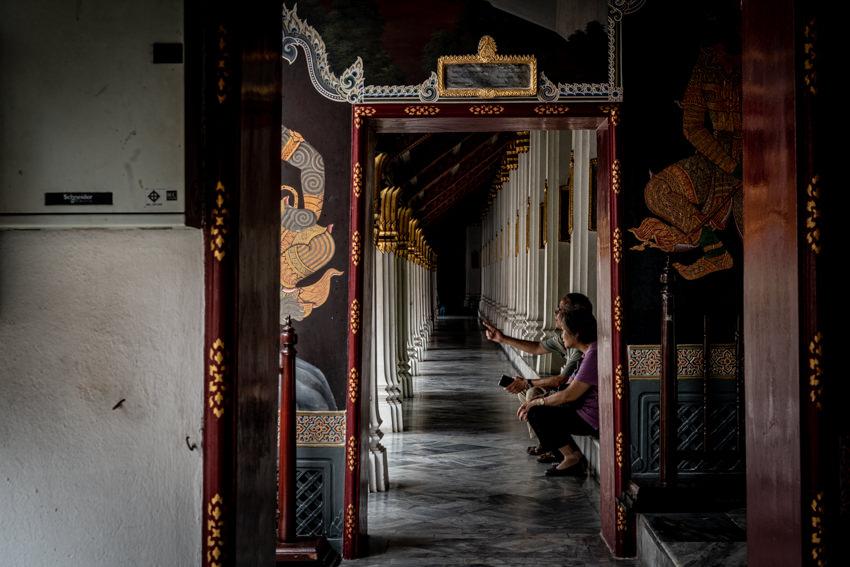 Old couple in cloister in Wat Phra Kaeo