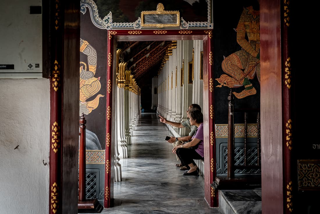 Old couple in cloister in Wat Phra Kaew