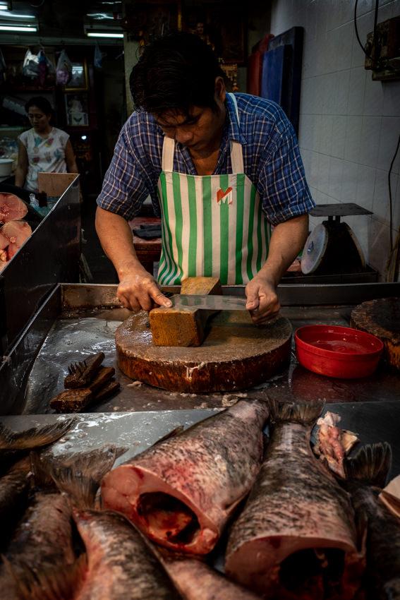Fishmonger sharpening a knife