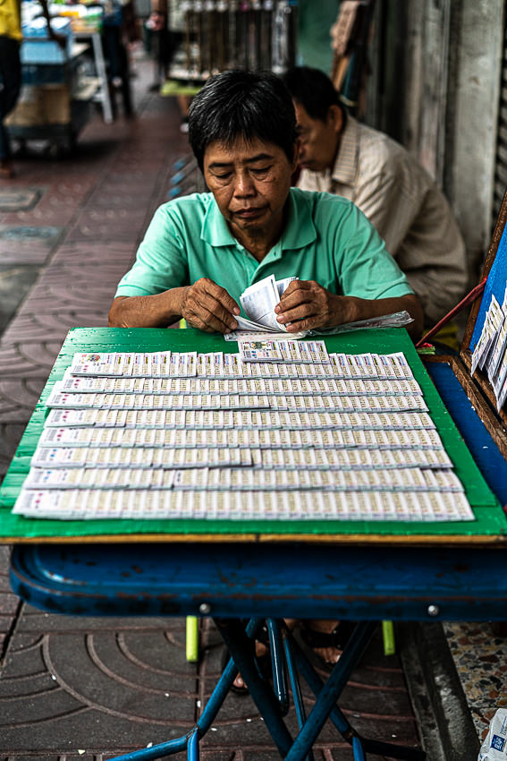 Woman selling lotteries