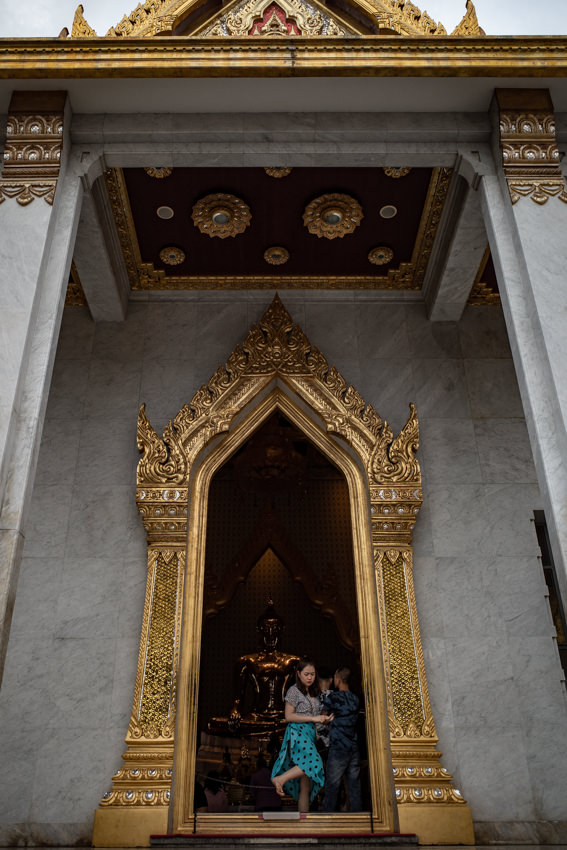 Woman coming out of Wat Trimit