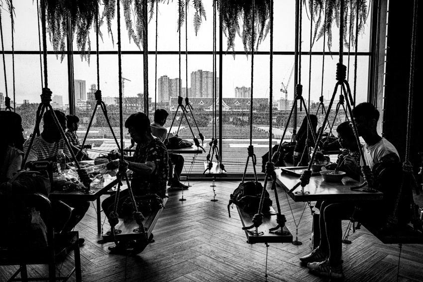 Silhoutted people having lunch in JJ Mall