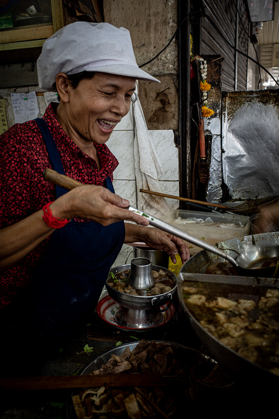 Woman boiling guts for noodles