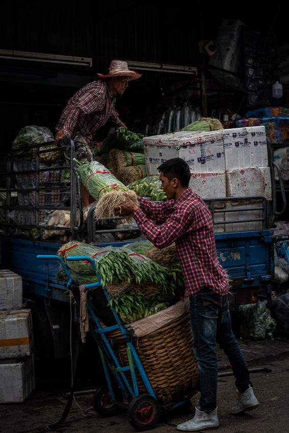 Two men unloading in Khlong Toei Market