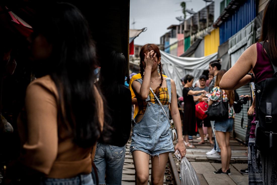 Tourists in Maeklong Railway Market