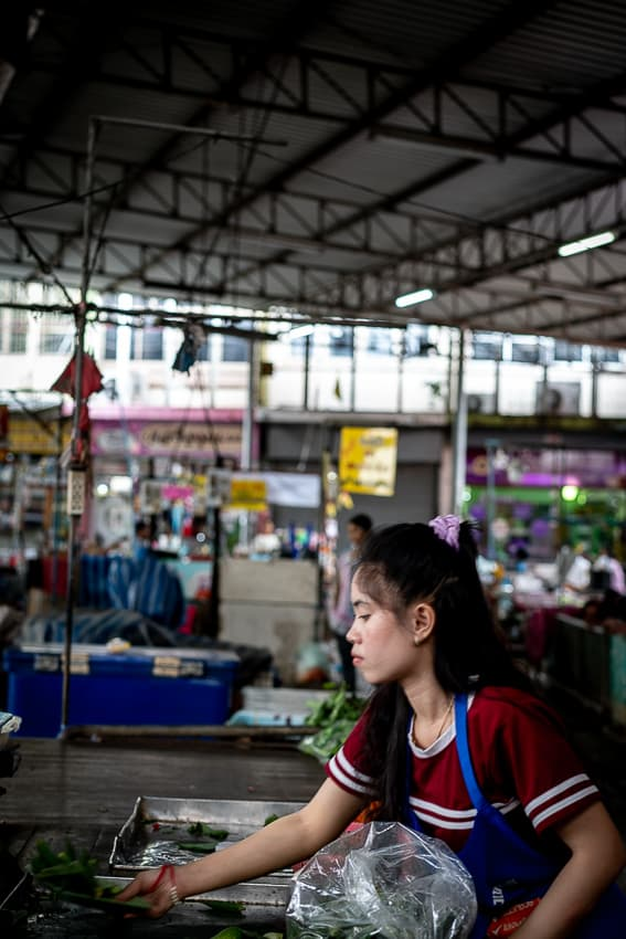Young woman working in the market in Mae Klong