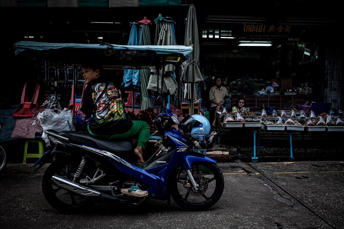 Woman sitting on a Honda motorbike
