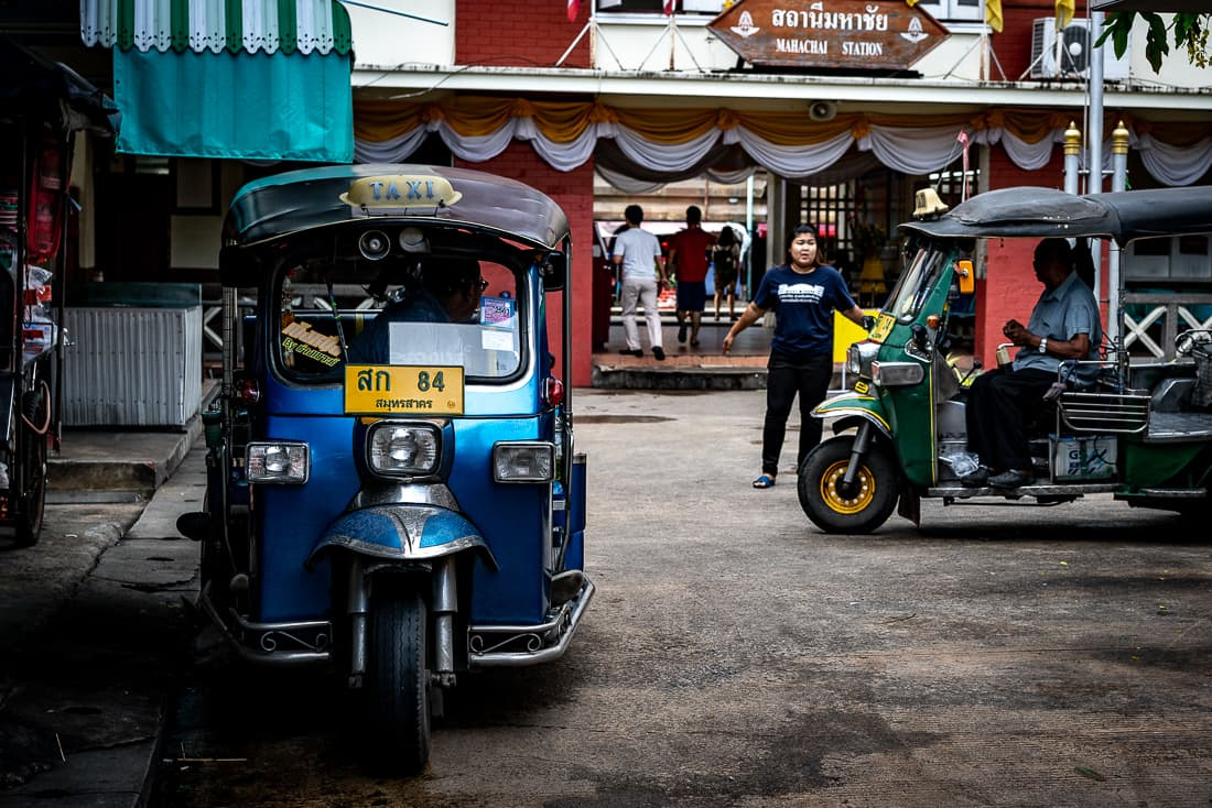 Two tuk-tuks in front of Mahachai station