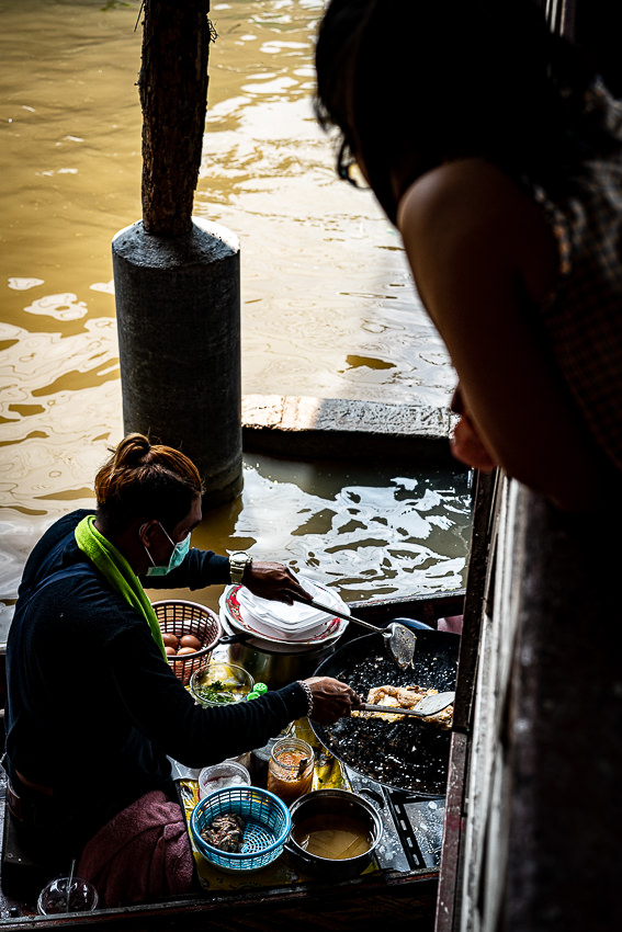 Girl watching the cooking on the boat