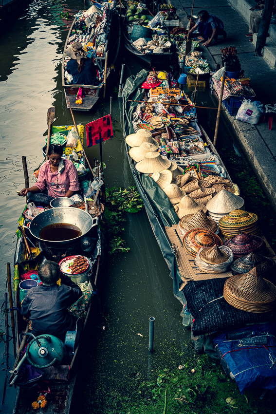 Big pot and many hats on boats