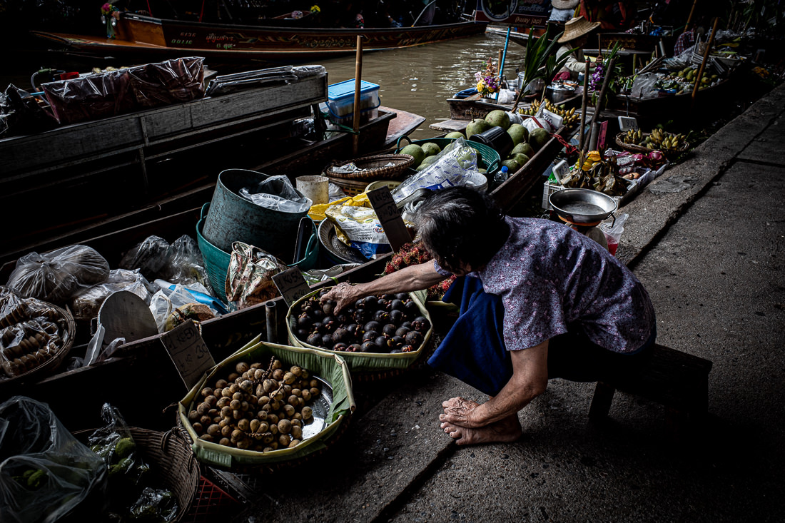 Woman reaching her hand for mangosteen