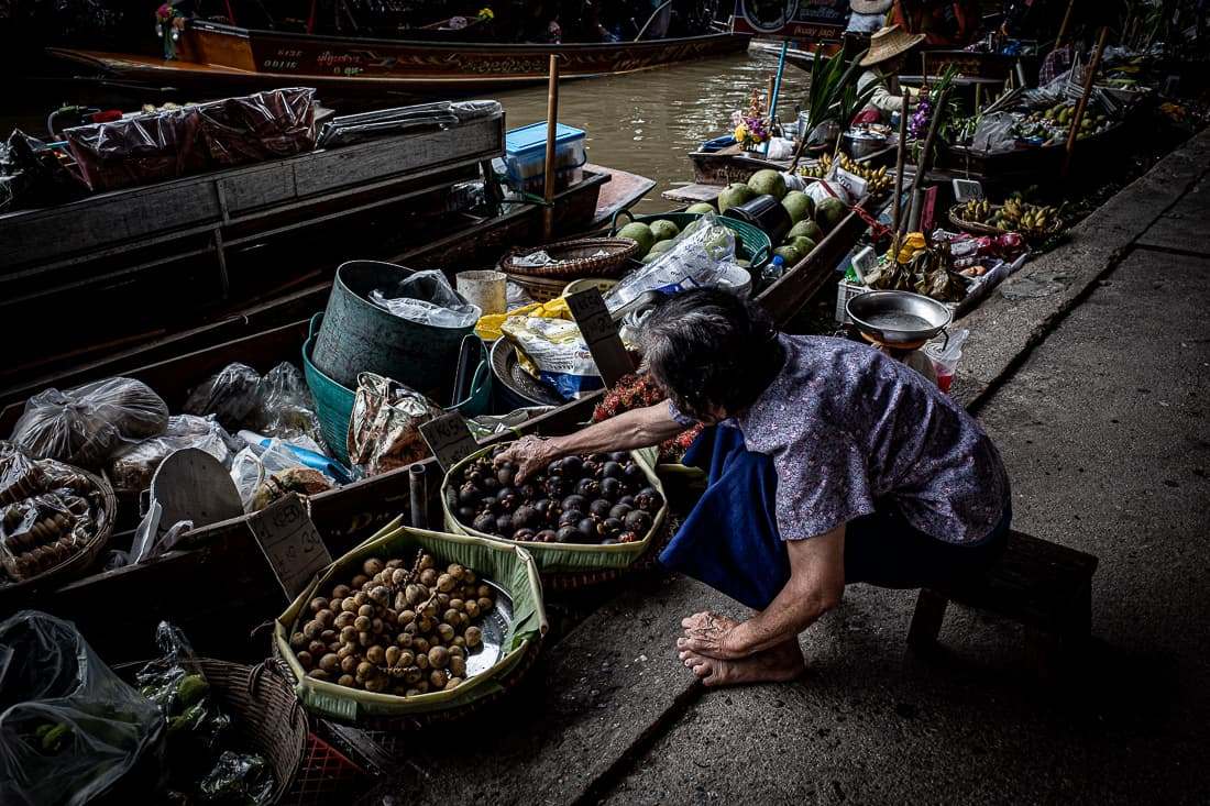 Woman reaching her hand for mangosteen