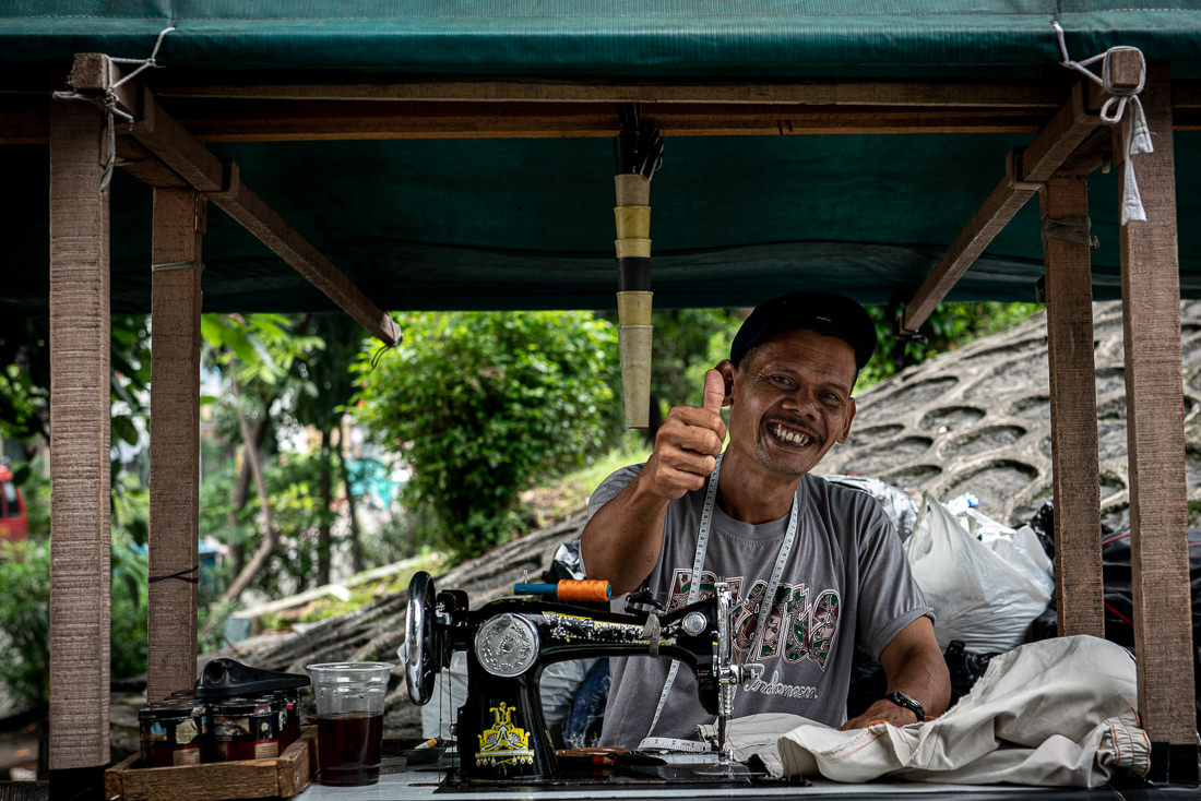 Tailor thumbing up cheerfully