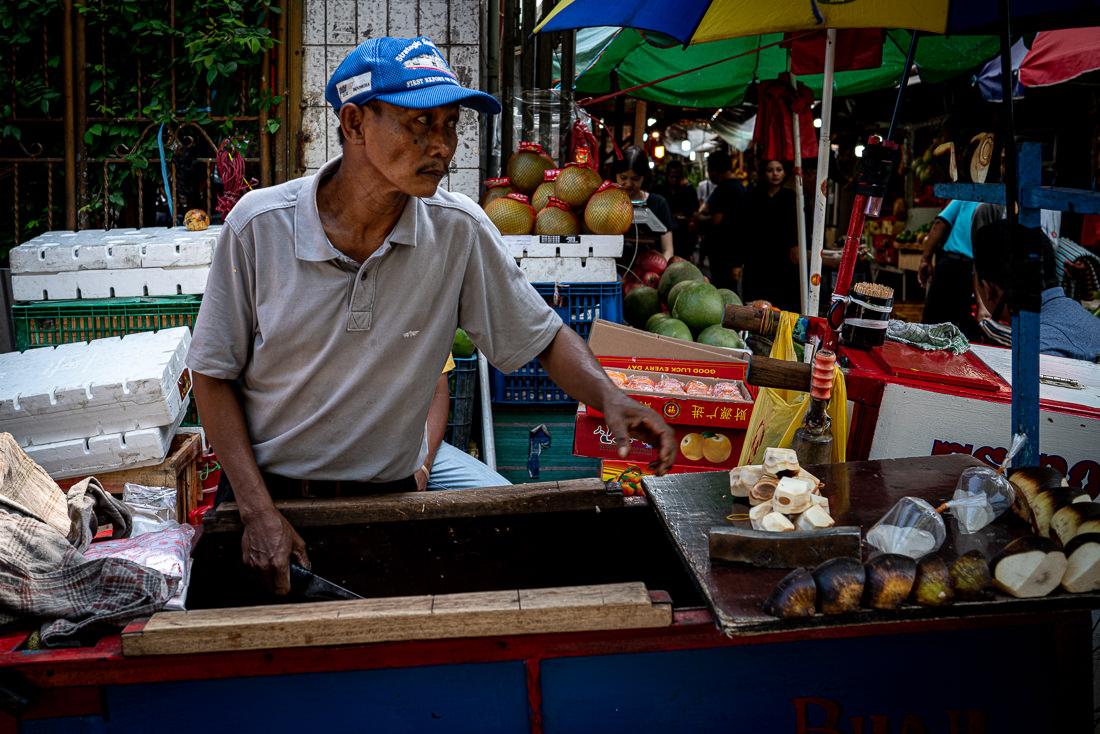 Coconut seller in Glodok district