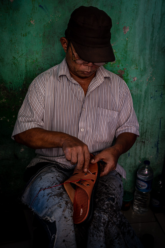Shoe repairman in the Glodok district