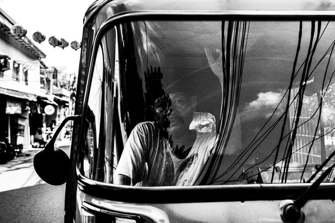 Bajaj parked by the roadside in Glodok, Jakarta