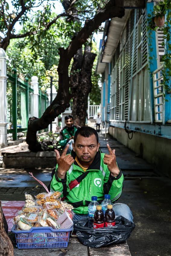 GOJEK driver resting in the tree shade
