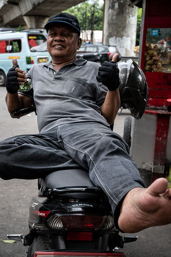 Motorbike taxi driver giving a happy thumbs up