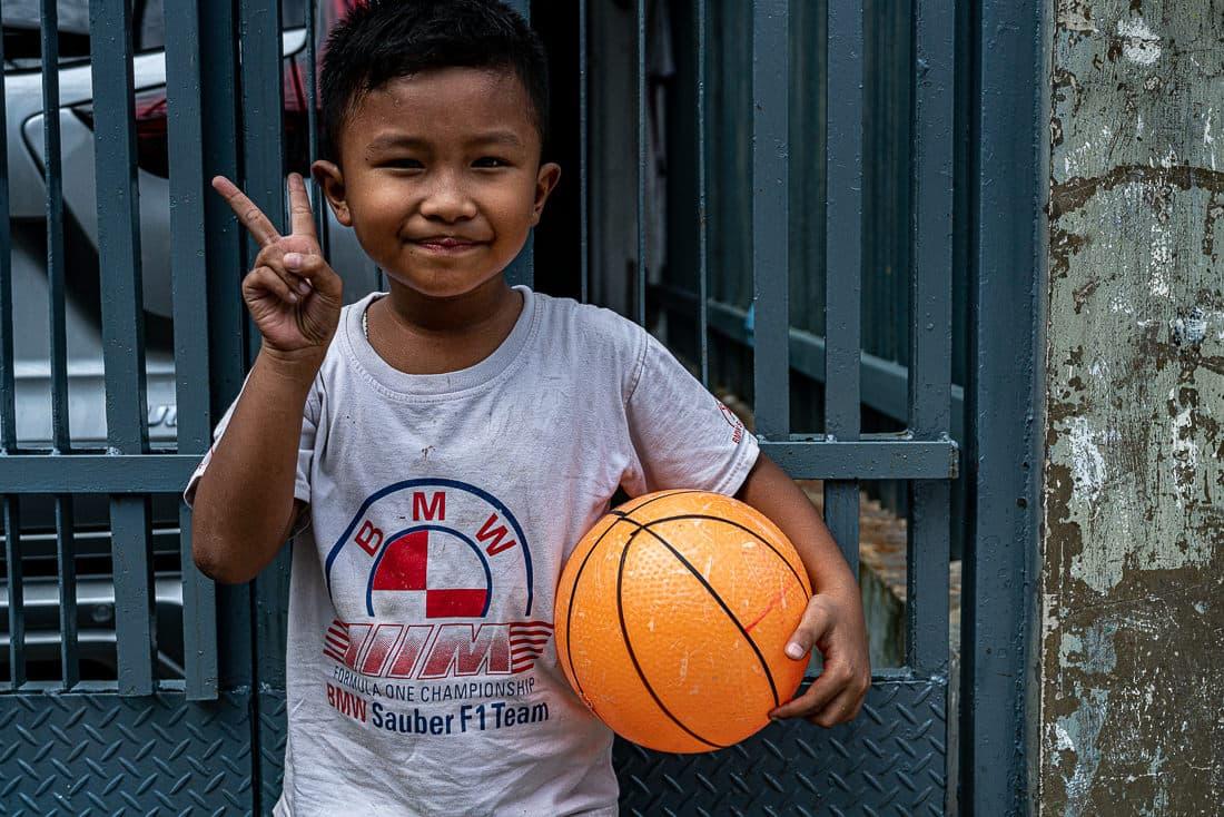 Boy throwing a deuce in Jakarta
