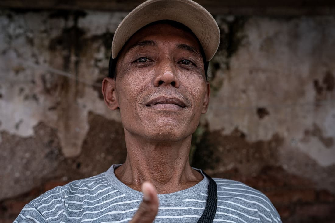 Man relaxing by the wayside in Jakarta