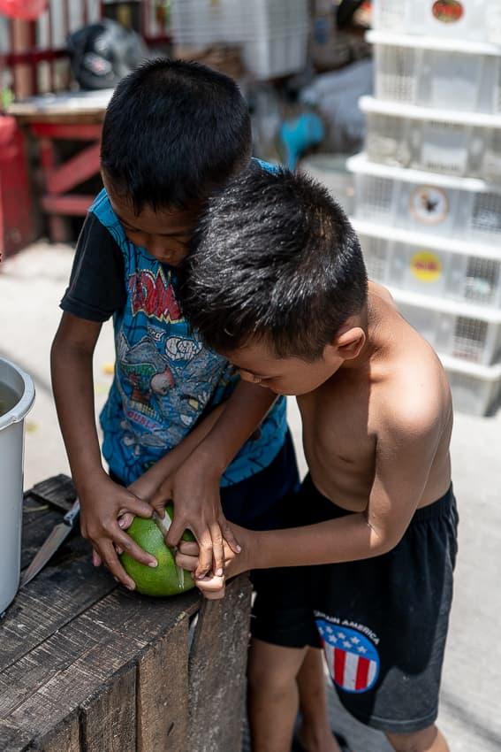 Boys eating a fruit in front of the temple