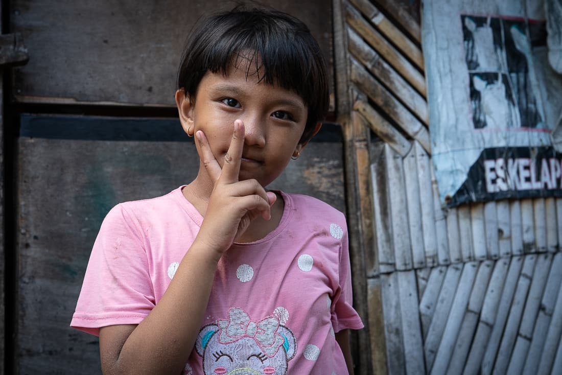 Girl making a peace sign