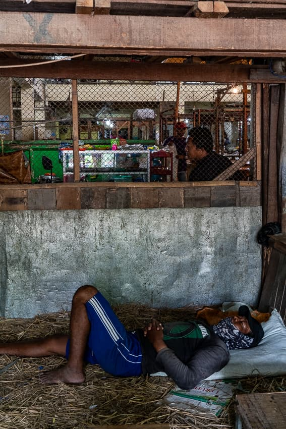 Man sleeping on straw scraps