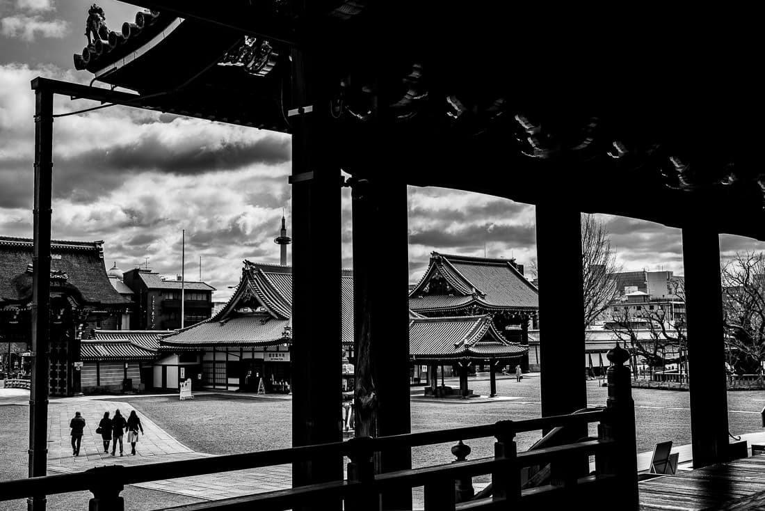 Figures walking in the precincts of Nishi Honganji Temple