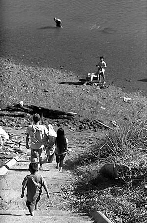 Boy descending to Nam Khan River