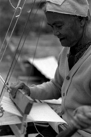 Older woman weaving