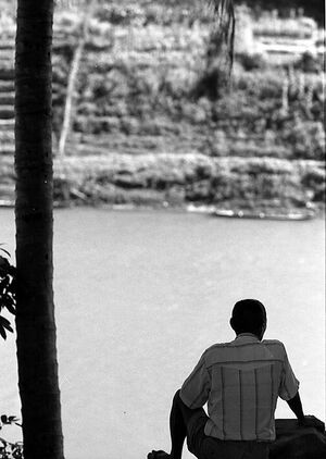 Man looking at Nam Khan river