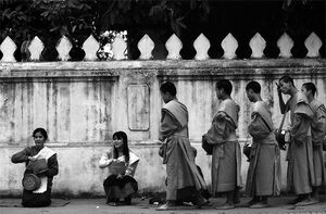 Buddhist monks waiting for their turn