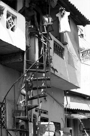 Naked boy climbing up spiral stairway