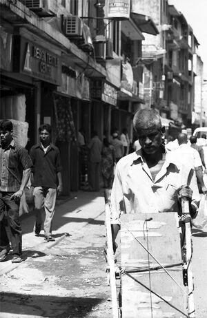 Man pushing empty cart