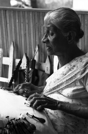 Older woman doing lacework