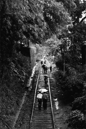 Local people walking on railway track