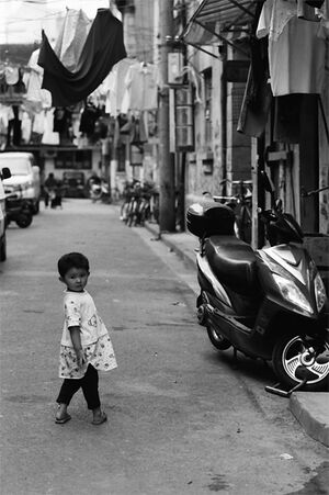 Little girl looking back in lane
