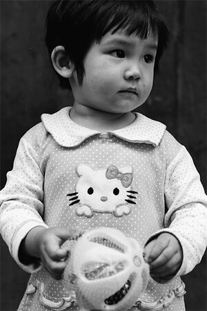 Little girl wearing clothes with Kitty