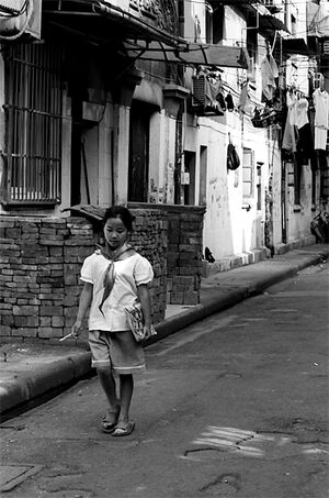 Girl walking lane with school uniform