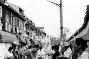 Woman standing still in street market